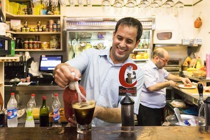 Server making drinks in Sevilla