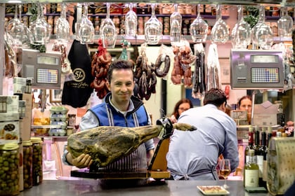 Man holding a piece of meat in Sevilla