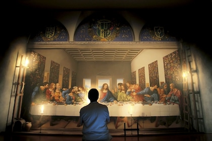 Man standing in front of the digital restoration of the Last Supper in Milano