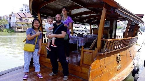 Family on a rice barge near Bangkok