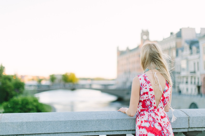 Show item 2 of 4. Woman looking at a lovely view of Stockholm