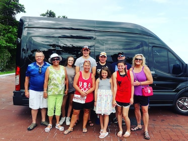 Group stands in front of tour shuttle in the Bahamas