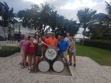 Group standing next to some barrels in the Bahamas