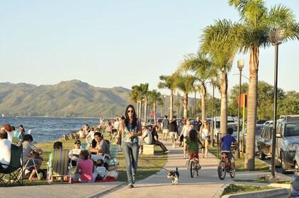 People congregate at the coastline in Villa Carlos Paz