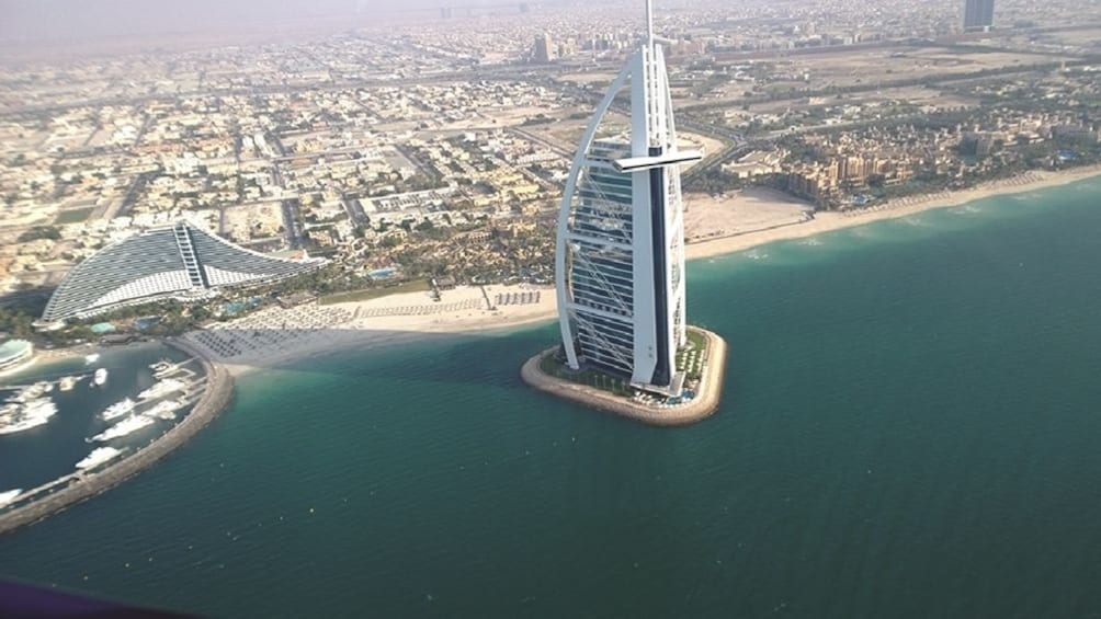 Show item 5 of 8. Helicopter tour from Dubai with Gray Line