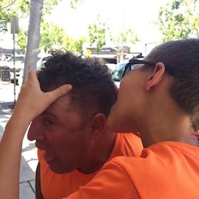 Boy holding a man's head