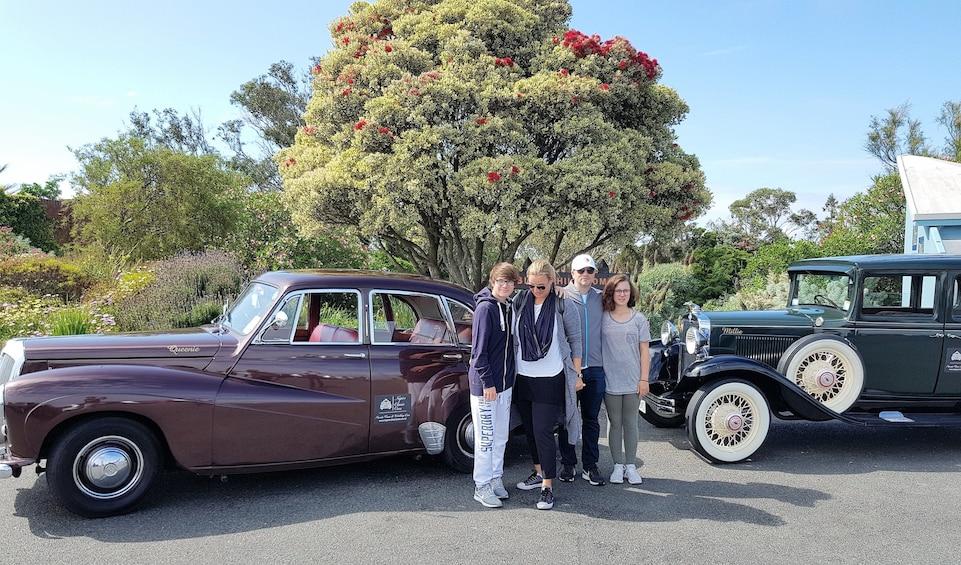 Show item 3 of 6. Tourists taking photos next to stunning authentic classic and vintage cars at the Art Deco City of Napier