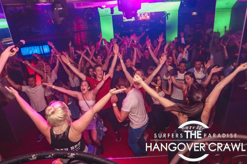 Show item 4 of 6. Group dancing at a club on The Hangover Crawl in Surfers Paradise