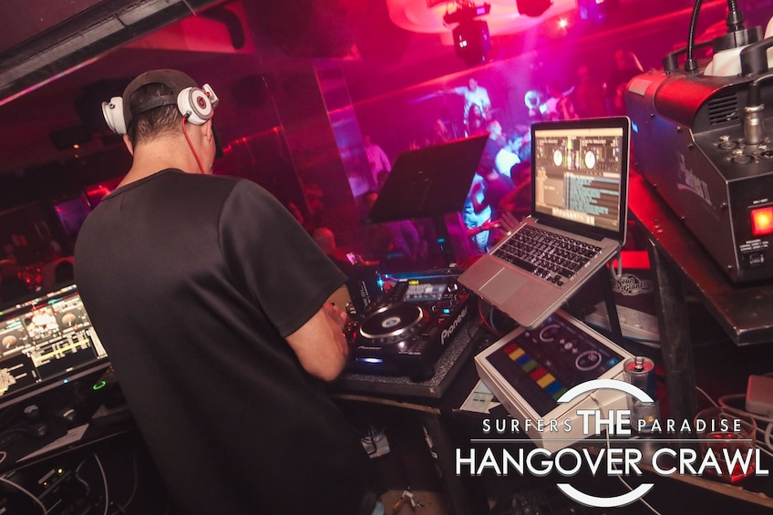 Show item 3 of 6. DJ mixing inside a club on The Hangover Crawl in Surfers Paradise