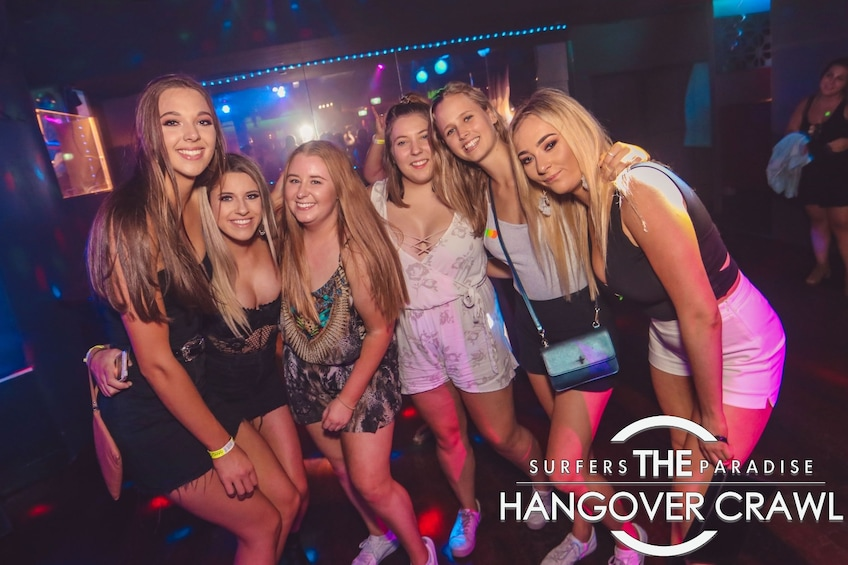 Show item 2 of 6. Ladies pose for a group photo on The Hangover Crawl in Surfers Paradise