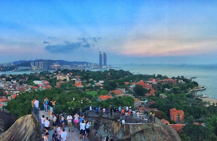 Visitors at a viewpoint overlooking Xiamen