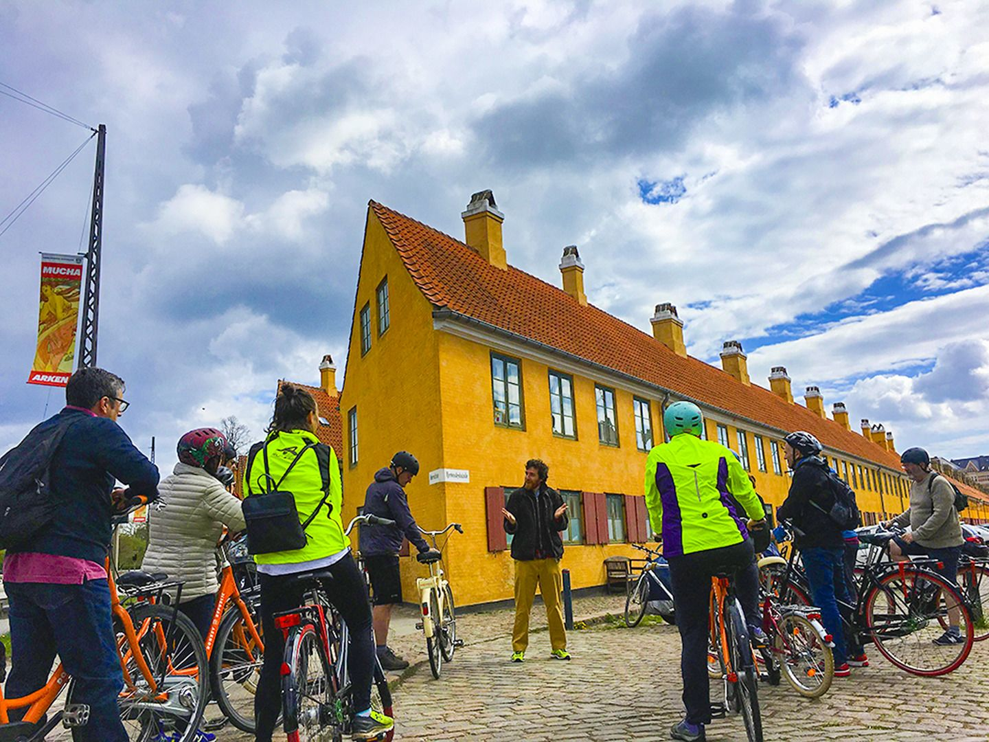 Group and guide on a bike tour of Copenhagens