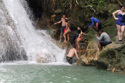 Tour group at the foot of a waterfall in Jamaica