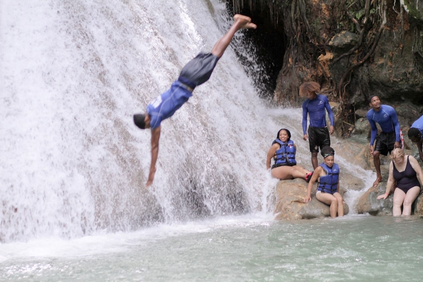 Show item 1 of 10. Man diving into waterfall pool in Jamaica