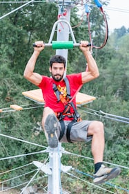 Man on a rope and pulley at an aerial adventure park in British Columbia