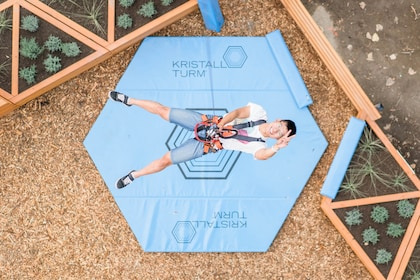 Man suspended from a rope around his waist at Rope Runner Aerial Adventure Park in British Columbia