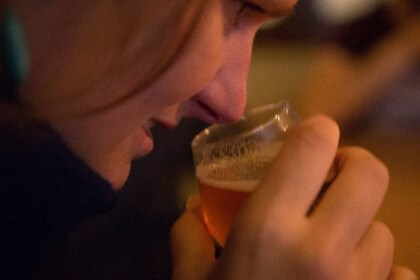 Woman smelling beer in Brussels