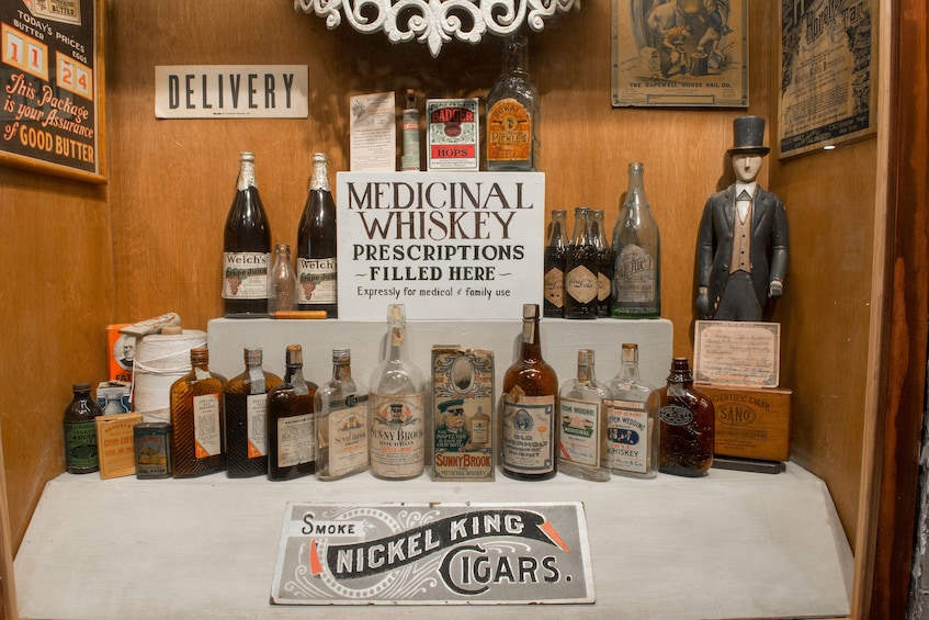 Show item 3 of 6. Medicinal Whiskey display at the American Prohibition Museum in Savannah