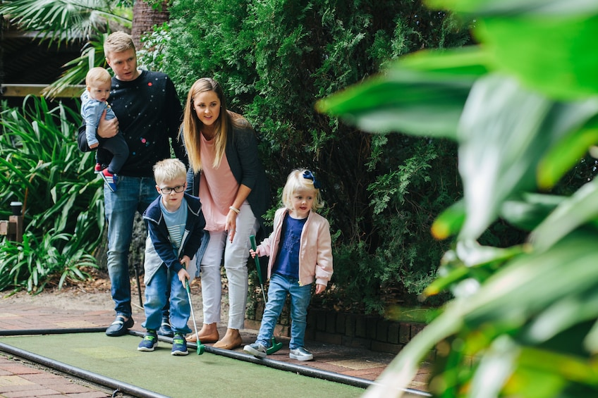 Family at the Wanneroo Botanic Gardens Mini Golf course
