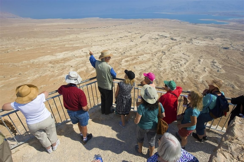 Show item 1 of 10. Tour group looking out from a scenic viewpoint in Israel