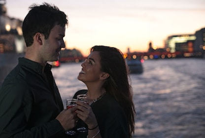 Couple on a evening cruise on the River Thames