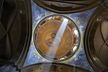 Light streaming through ceiling mural in a church in Jerusalem