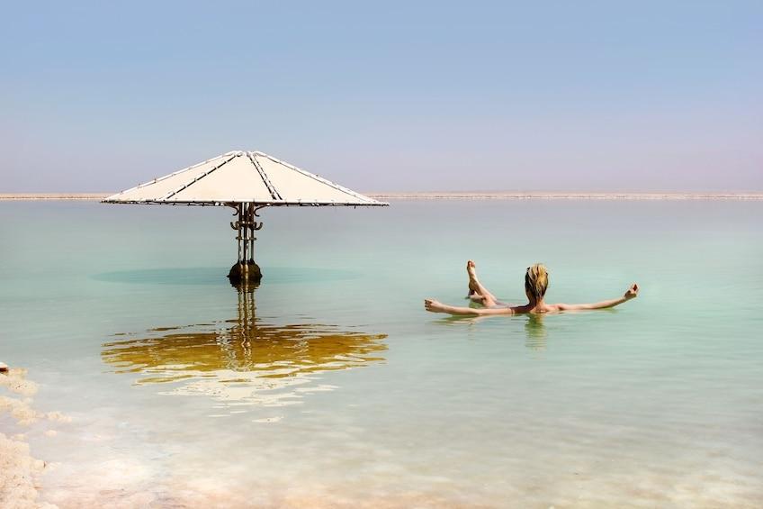Woman floating in the Dead Sea in Jerusalem