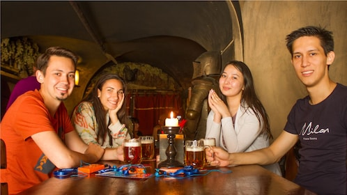 Tour group drinking beer at a bar in Prague