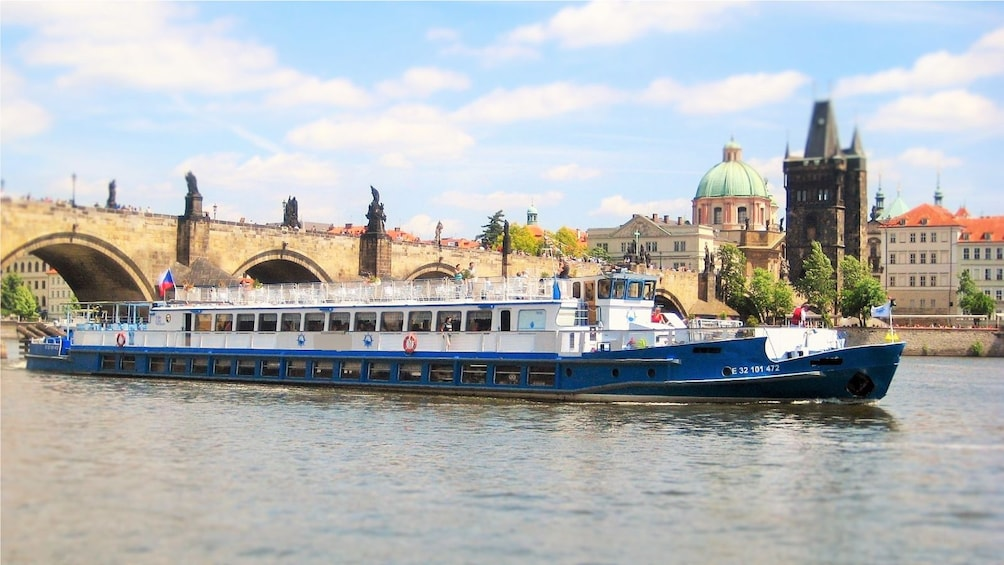 Show item 2 of 9. Cruise boat on the river in Prague