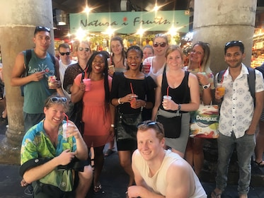 Group holding drinks and food while on the tapas evening walking tour in Barcelona
