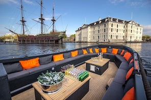 Luxury canal open boat Cruise departure Anne Frank House