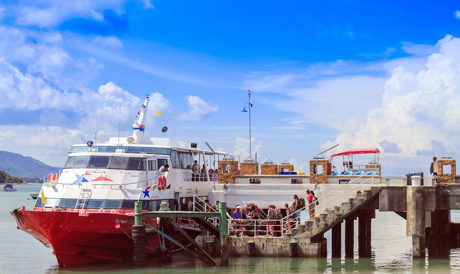 Show item 2 of 7. Ferry docked at Bangrak Pier during the day