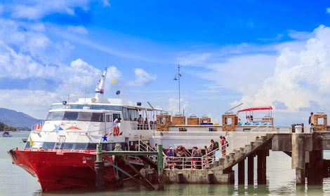 Ferry docked at Bangrak Pier during the day
