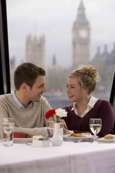 Show item 5 of 7. Couple having lunch on a River Thames cruise with Big Ben in the background