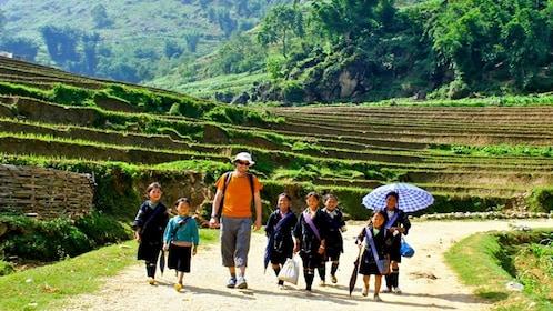 Tourist and local children of Sapa