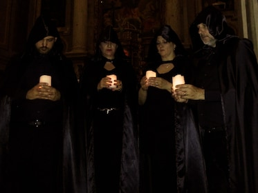 Opera singers in a crypt with candle light