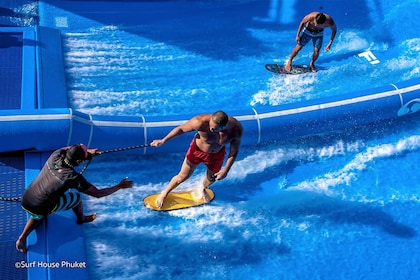 View of guests surfing on a Flowrider at 