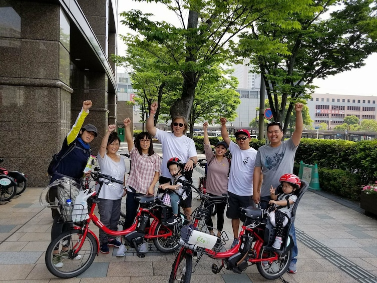 Group standing next to electric bikes in Hiroshima
