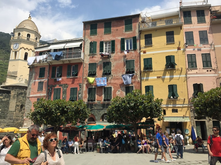 Show item 5 of 9. Tourists walking around Vernazza, Italy