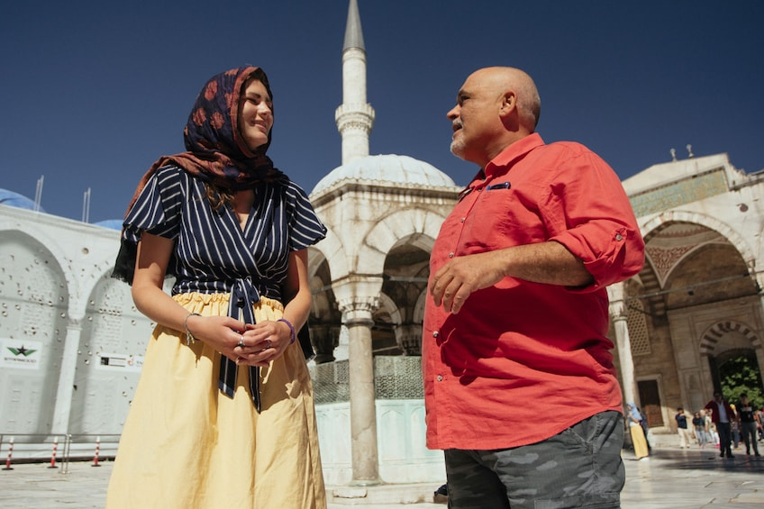 Show item 9 of 9. Two people outside Sultan Ahmed Mosque