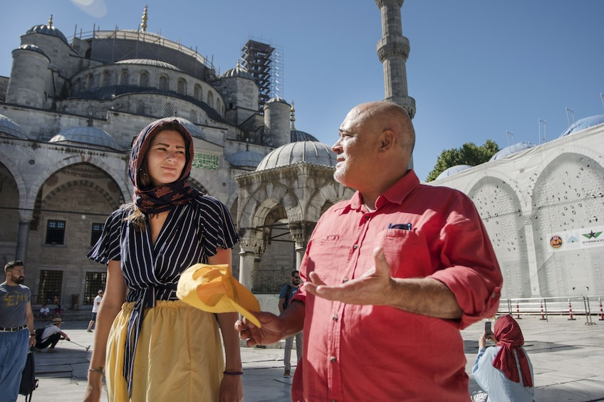 Show item 3 of 9. Two people outside Sultan Ahmed Mosque