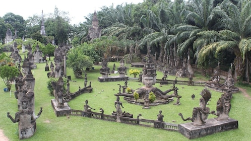 Religious statues and palm grove in Vientiane