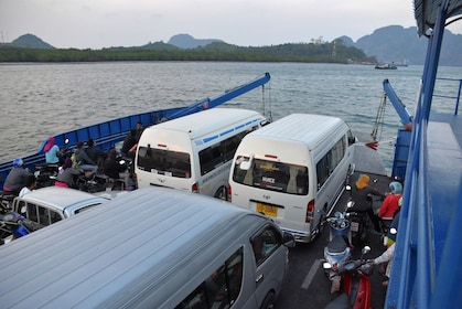 Parked vehicles being transported on a Seatran Discovery ferry in Thailand