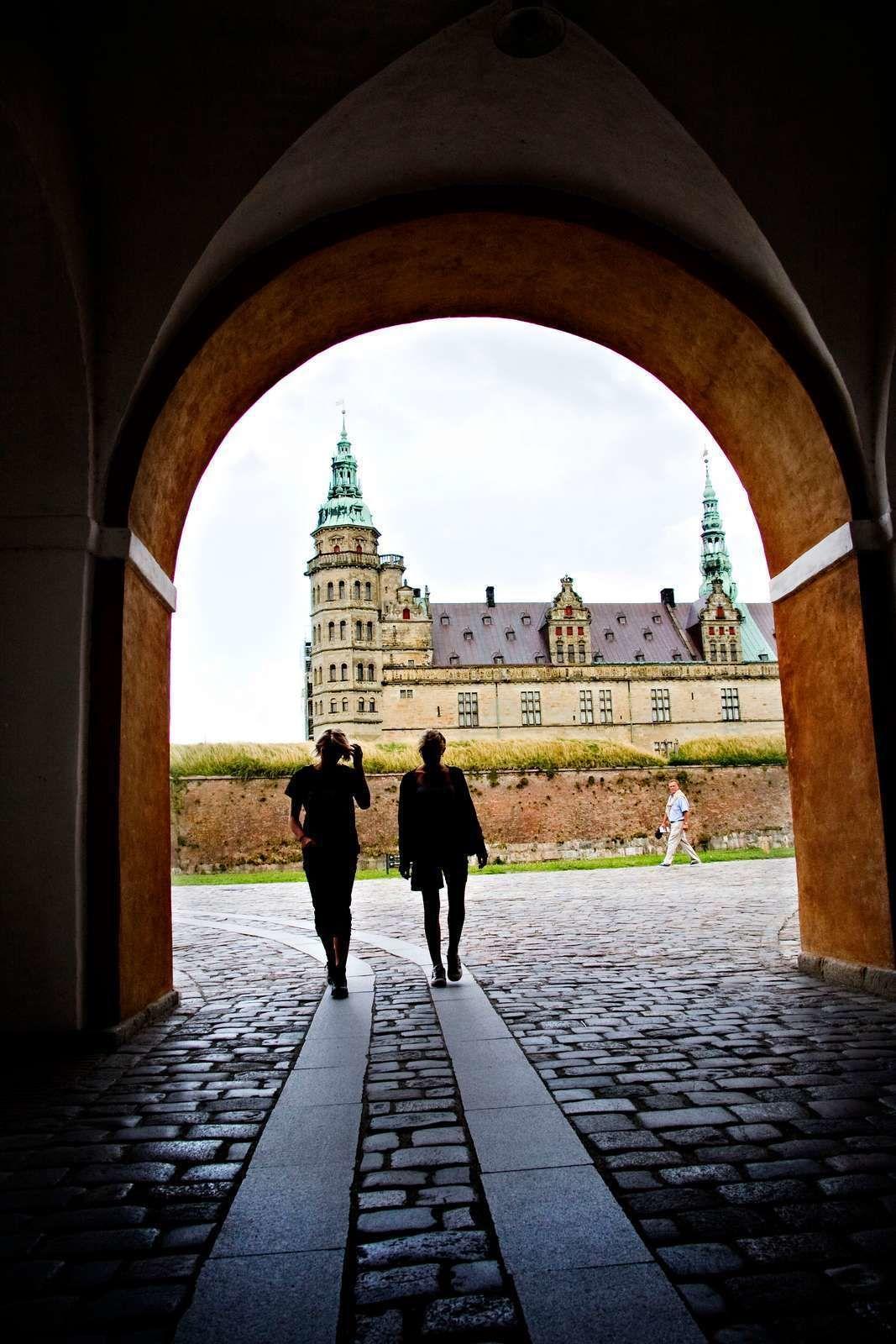 Silhouette of women walking near a castle in Denmark