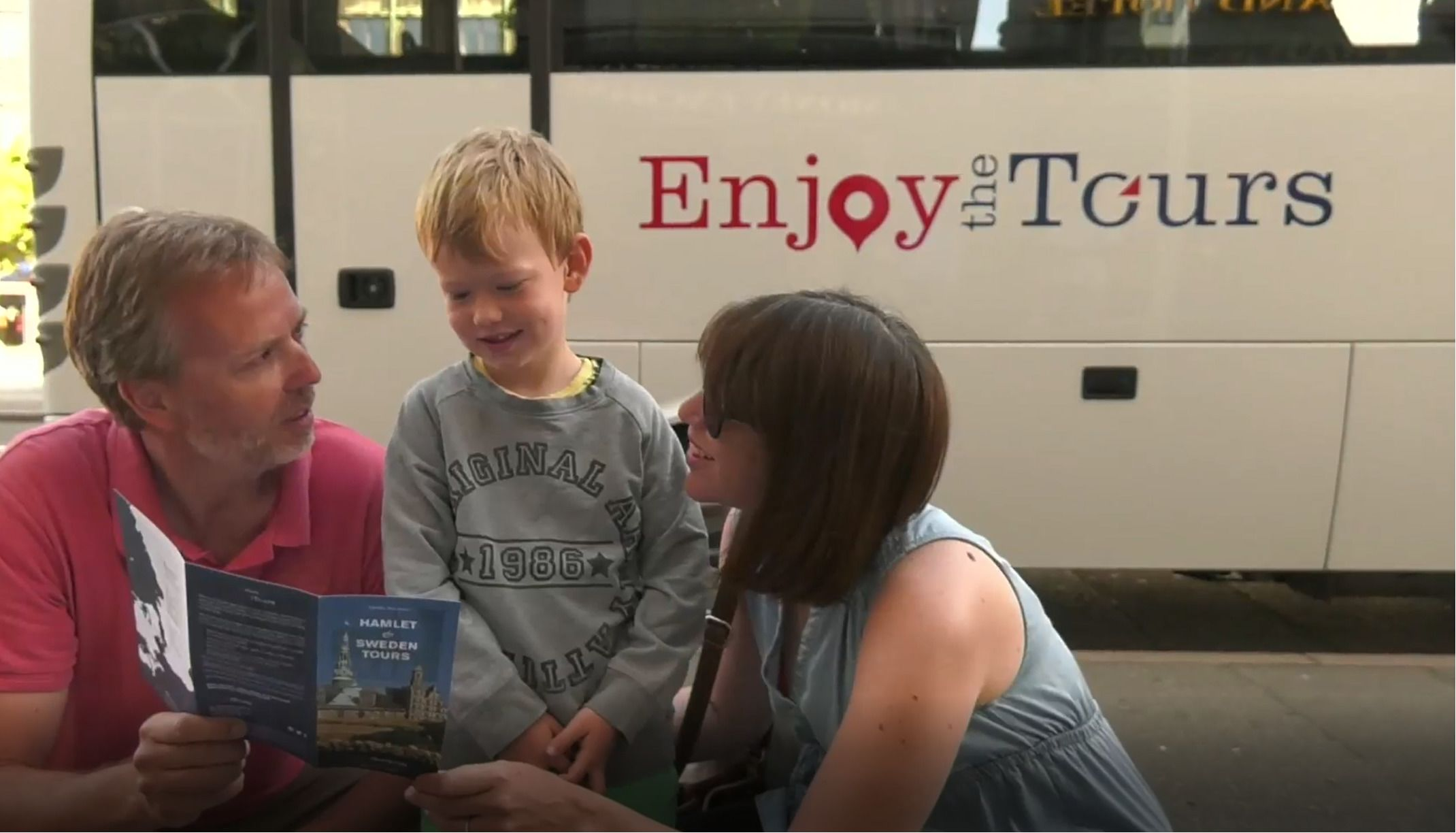 Family next to tour bus in Denmark
