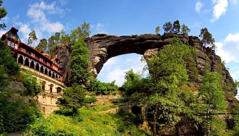 Hotel and arched rock formation in the mountains in Switzerland
