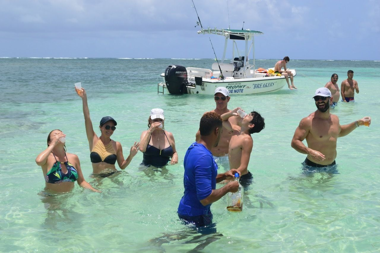 Group drinking while standing in the waters of Punta Cana on a clear day