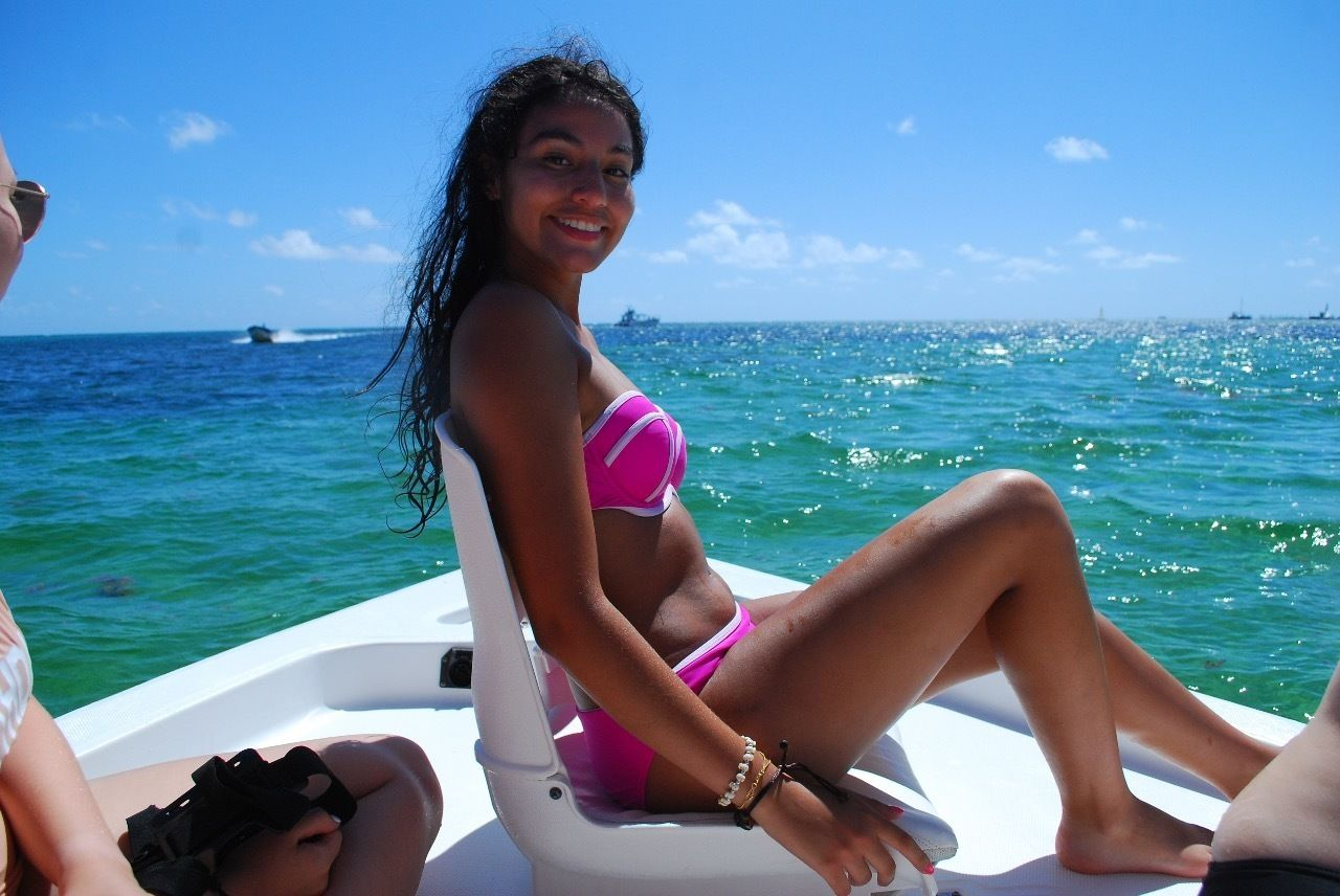 Woman sitting aboard a motorboat in Punta Cana