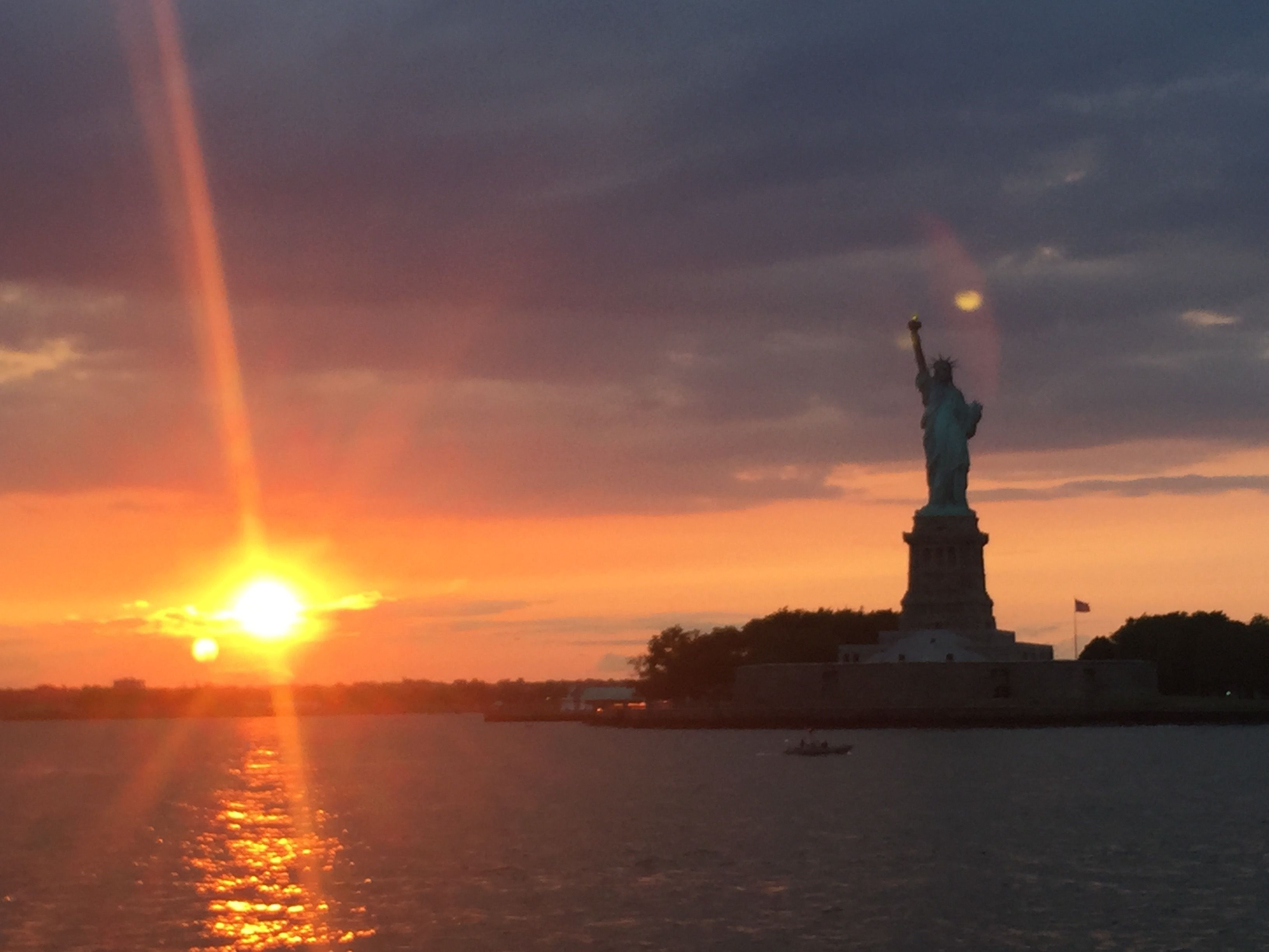 Sunset next to the Statue of Liberty