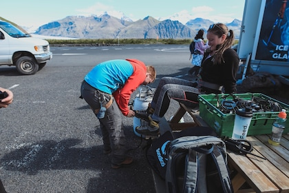 Woman being fitted with hiking boots in Iceland